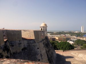 Cartagena: View from Castillo de San Felipe de Barajas. To the right of the tan department store is one of the city's completed but unused BRT stations. Photo by Author.
