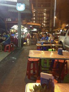 Street food vendors in Bangkok's Ari neighborhood prepare to close up as the last customers of the night head home.