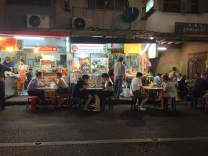 Street food patrons dine on the road at Bangkok's well-known Sukhumvit Soi 38