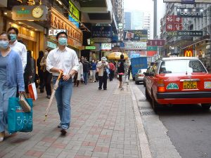 Residents of Hong Kong wear masks during the SARS epidemic in 2003. Photo by  faux-tographer on Flickr.