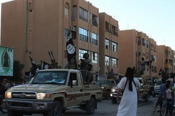 An image made available by Jihadist media outlet Welayat Raqqa on June 30, 2014, allegedly shows a member of the IS (Islamic state) militant group parading in a street in the northern rebel-held Syrian city of Raqqa. (Photo: AFP-Welayat Raqqa)