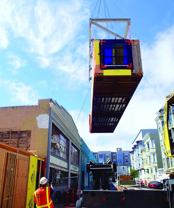 A modular house being moved into place. Photo: San Francisco Business Times