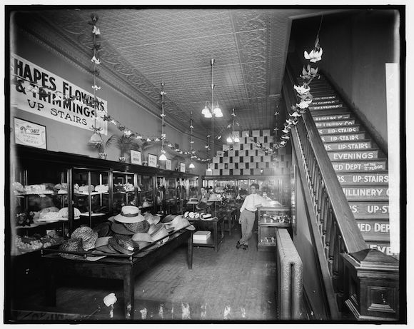 A photograph, possibly taken by the gas company, shows off the light fixtures in a Detroit millinery store.